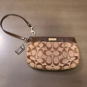 New without tags, tan and brown Coach wristlet
